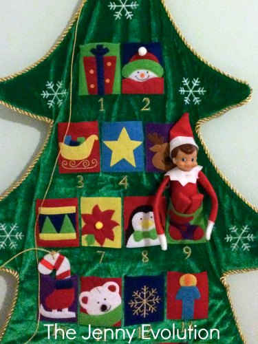 Elf on the shelf Curls up in the Advent Tree Calendar. For more #elfontheshelf #elfideas
