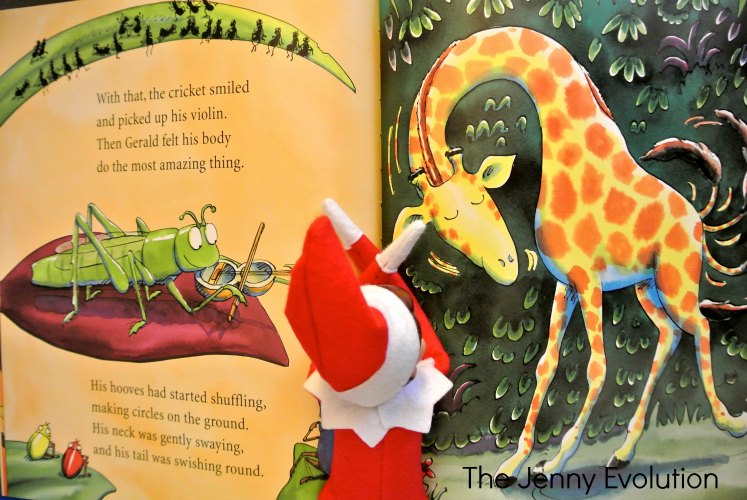 Elf on the Shelf Reads a Favorite Book -- Giraffes Can't Dance. #elfontheshelf