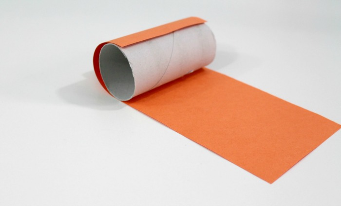 4 cover your toilet paper roll with orange paper