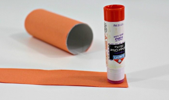 5 one strip at a time put glue on the ends of the strips of paper and press to the inside of the roll