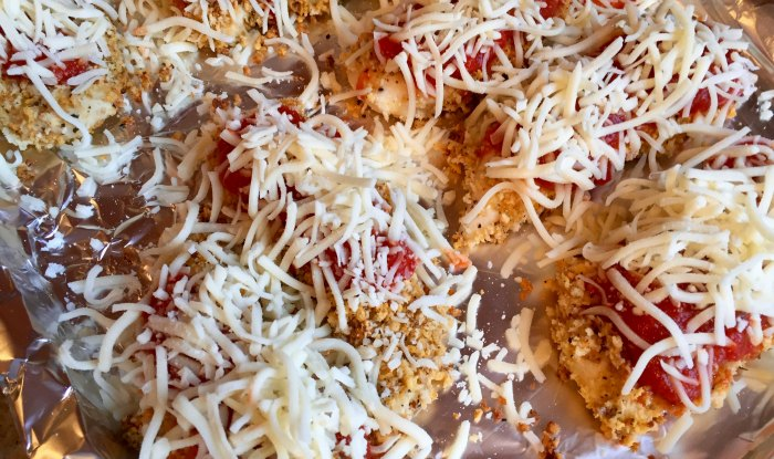Sprinkle Cheese over Chicken