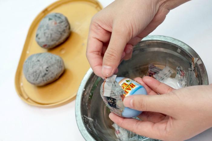 Cover plastic eggs with paper mache