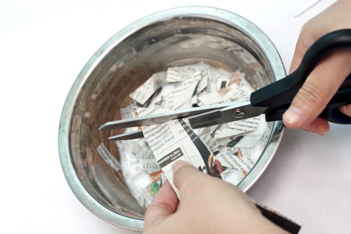 Cut newspaper strips for paper mache
