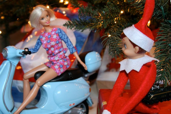 Barbie and Elf on the Shelf go for a ride on her scooter.