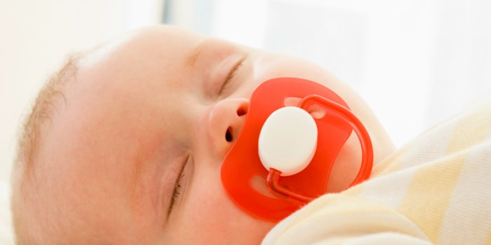 baby peacefully sleeping with pacifier