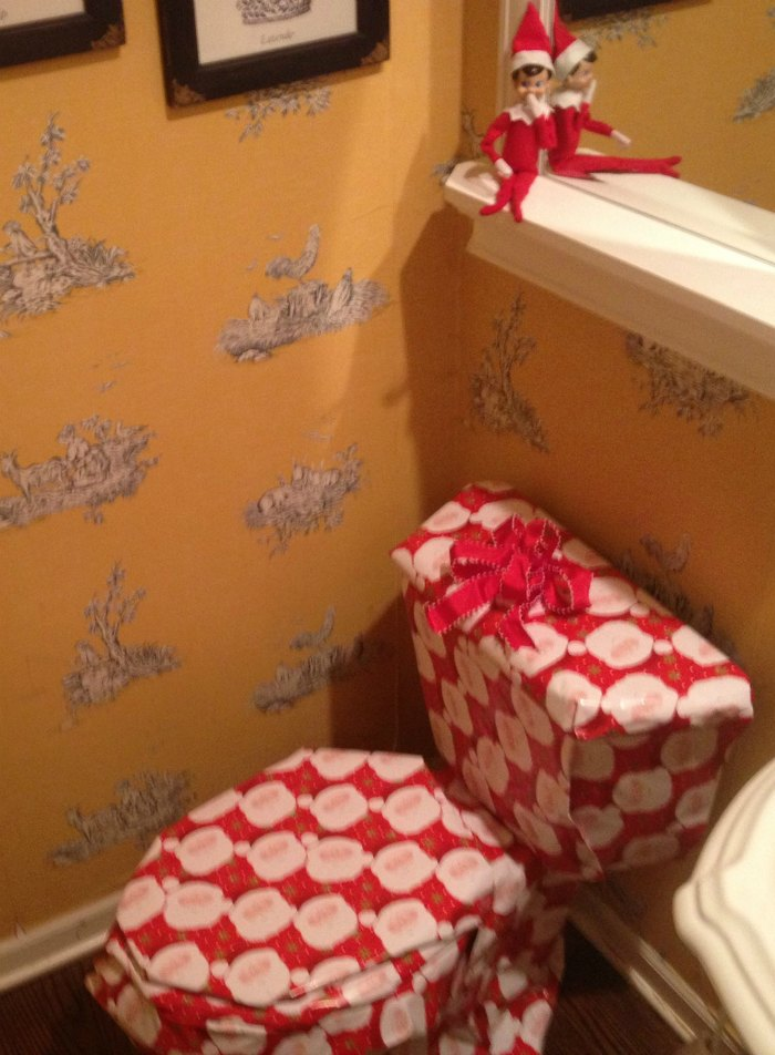 Elf on the Shelf Wrapped the Toilet Bowl in Santa Wrapping Paper | Mommy Evolution #elfontheshelfideas #elfontheshelf