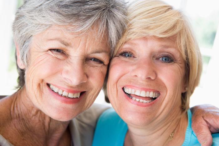 two senior women friends smling