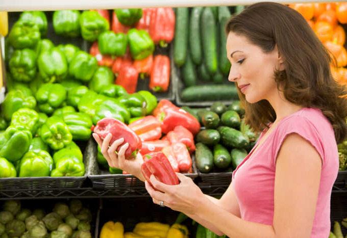 Woman choosing fresh produce in supermarket